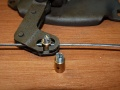 End piece for bowden cable with screw