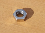 Nut of wheel axis - original width - polished stainlees